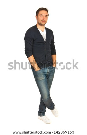 Cheerful casual man standing with hands to pockets jeans and legs crosed isolated onw hite background - stock photo