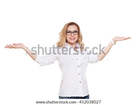 Cheerful caucasian lady in eyeglasses with open hands holding or showing something isolated at white background. Blond middle-aged attractive woman in glasses, happy and positive - stock photo