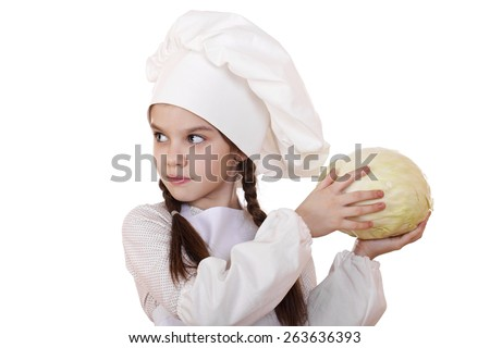 Cheerful caucasian little girl in cook hat holding a head of cabbage, isolated on white background - stock photo