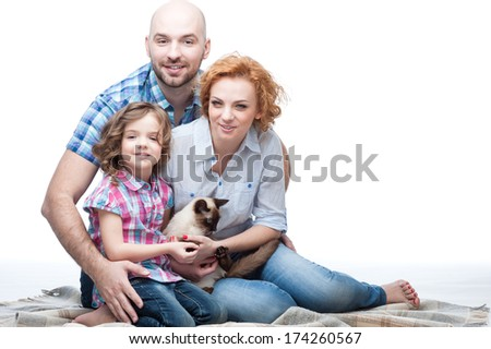 cheerful caucasian smiling happy family hugging isolated on white - stock photo