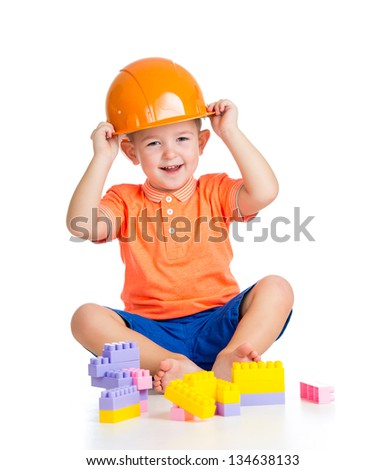 cheerful child boy  playing with building blocks toys over white - stock photo