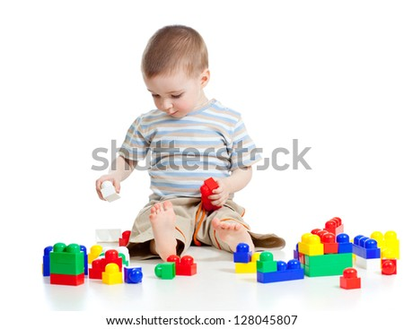 cheerful child boy with construction set over white background - stock photo