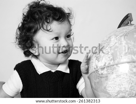Cheerful child with globe. - stock photo