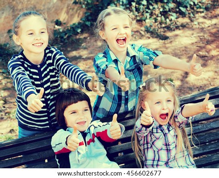 Cheerful children holding hands and giving friendship swear - stock photo