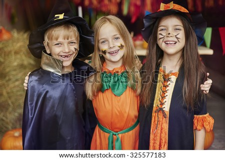 Cheerful children with Halloween face paint - stock photo