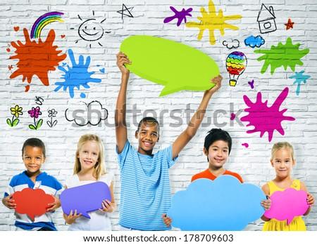 Cheerful Children with Multi Colored Speech Bubbles - stock photo