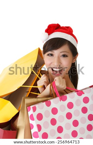 Cheerful Christmas lady holding shopping bags and smiling, closeup portrait isolated on white background. - stock photo