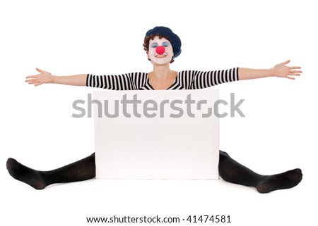 cheerful clown woman seated on floor and presenting white billboard - stock photo