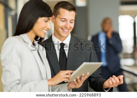 cheerful colleagues using tablet pc  - stock photo