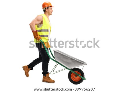 Cheerful construction worker pushing an empty wheelbarrow isolated on white background - stock photo