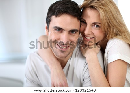 Cheerful couple embracing each other - stock photo