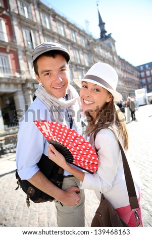 Cheerful couple enjoying tour in Madrid - stock photo