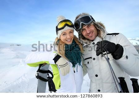 Cheerful couple enjoying winter vacation - stock photo