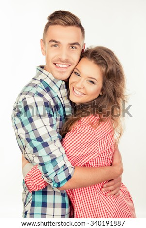 Cheerful couple in love embracing each other - stock photo