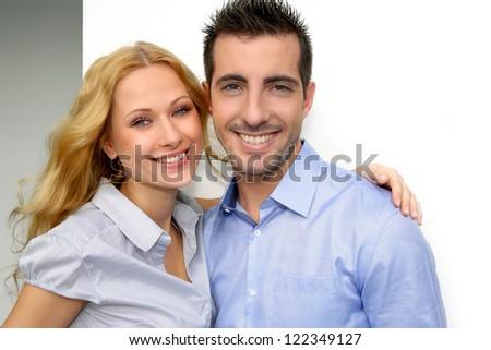 Cheerful couple looking at camera - stock photo