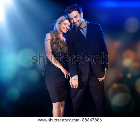 Cheerful couple posing - stock photo