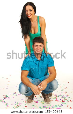Cheerful couple posing with confetti  against white - stock photo
