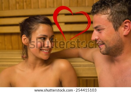Cheerful couple relaxing in a sauna and chatting against heart - stock photo