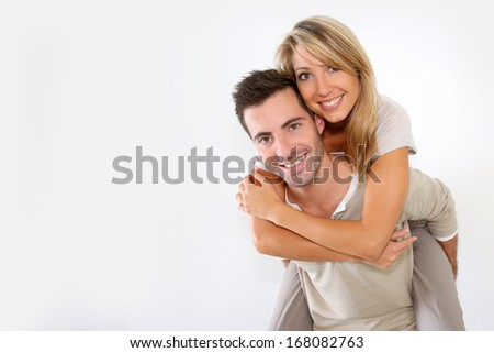 Cheerful couple standing on white background - stock photo