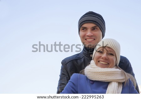 Cheerful couple together  at winter time - stock photo