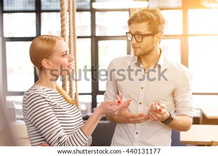 Cheerful creative team talking about work - stock photo