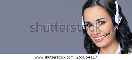 Cheerful customer support phone female operator in headset, with blank copyspace area for text or slogan, over violet background - stock photo