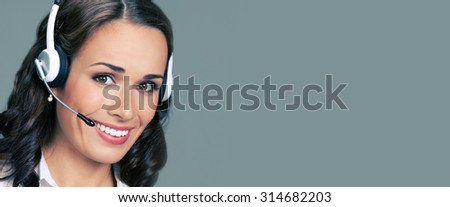 Cheerful customer support phone female operator in headset, with blank copyspace area for text or slogan - stock photo