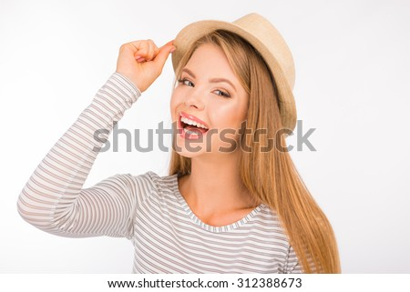 cheerful cute girl with hat smiling - stock photo