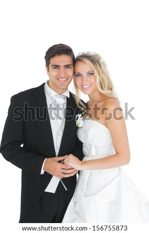 Cheerful cute married couple posing holding hands on white background  - stock photo