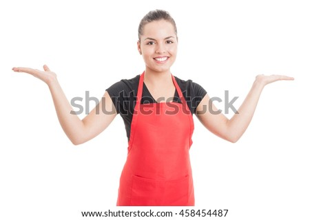 Cheerful employee holding something in her palms with advertising area isolated on white background - stock photo