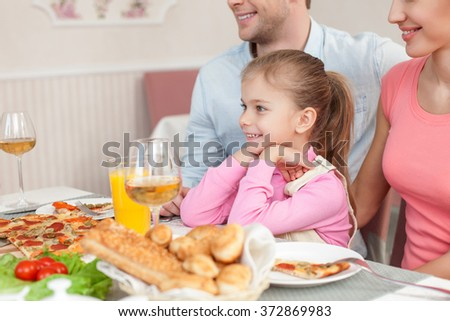 Cheerful family is dining in restaurant - stock photo