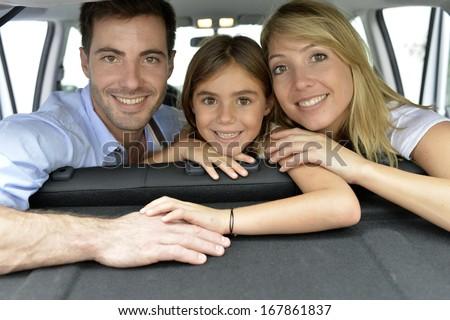 Cheerful family of three ready for vacation - stock photo