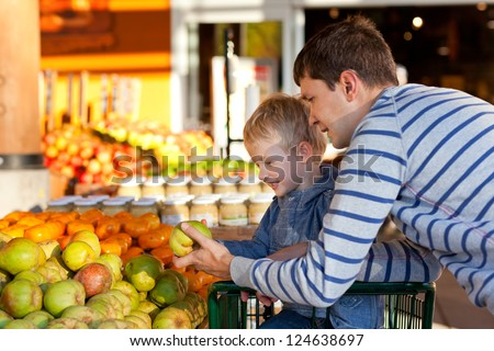 cheerful family of two at the farmers market - stock photo