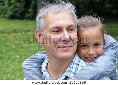 Cheerful father and daughter - stock photo