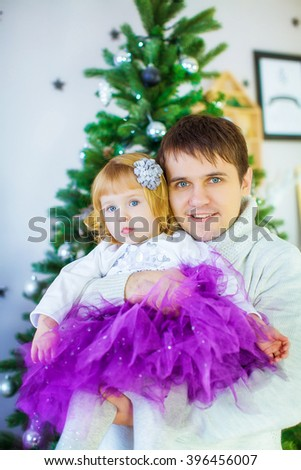 Cheerful father and his little daughter with Christmas mood. New year. - stock photo