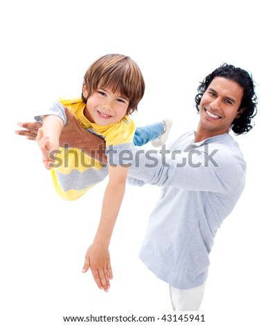 Cheerful father having fun with his son against a white background - stock photo