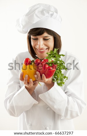 Cheerful Female Chef With Vegetables - stock photo