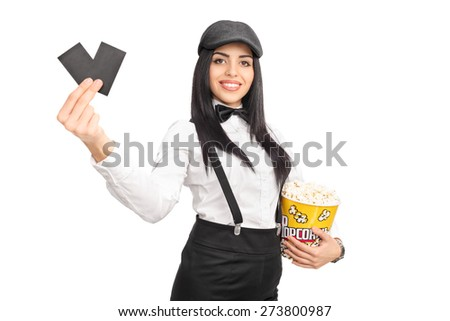 Cheerful female movie director holding a box of popcorn and two tickets isolated on white background - stock photo