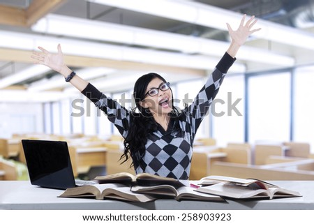 Cheerful female student is learning in the class - stock photo