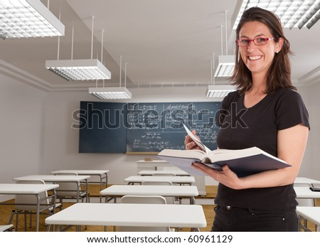 Cheerful female teacher in a maths classroom - stock photo