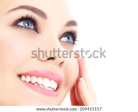 Cheerful female with fresh clear skin, white background.  - stock photo
