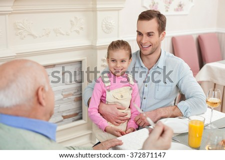 Cheerful friendly family has a lunch together - stock photo