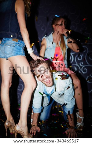 Cheerful friends celebrating holiday in club - stock photo