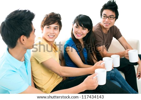 Cheerful friends spending time together communicating - stock photo