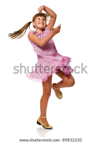 Cheerful girl dancing on floor isolated on white - stock photo