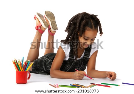 cheerful girl draws pencil lying on the floor - stock photo