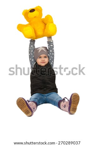 cheerful girl holding a teddy bear on her head. Isolation on a white background - stock photo