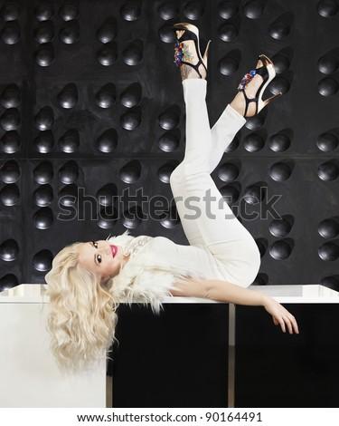 Cheerful girl in a modern interior - stock photo