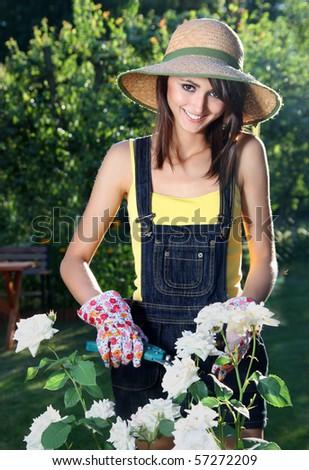 Cheerful girl in the garden - stock photo