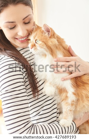 Cheerful girl is hugging her lovely pet - stock photo